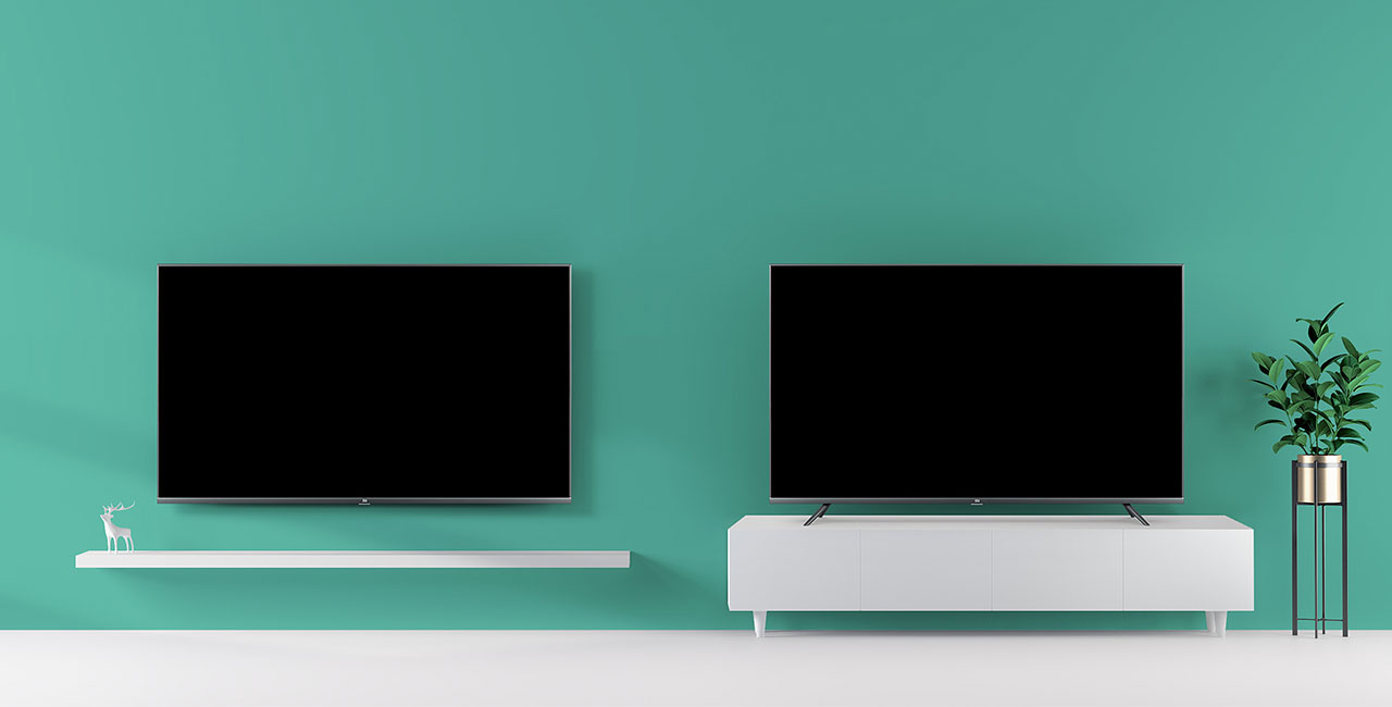 Xiaomi Mi Tv 4S na steni in mizi